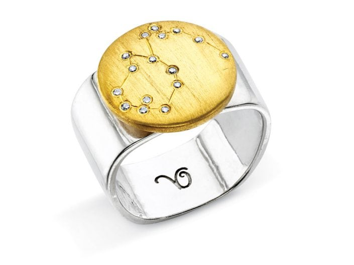 Ring of 22k gold disc atop a sterling silver band features glittering high-quality diamonds outlining star sign constellation of Aquarius.
