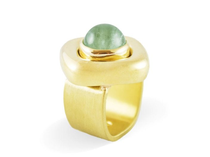 Modern blue-green aquamarine stone in a 18k gold setting atop a brushed, 18k gold band.