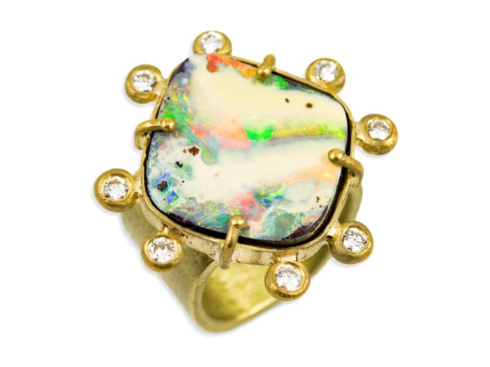 Large, beautiful boulder opal surrounded by 8 diamonds and set in 22k gold atop a 18k gold brushed band.
