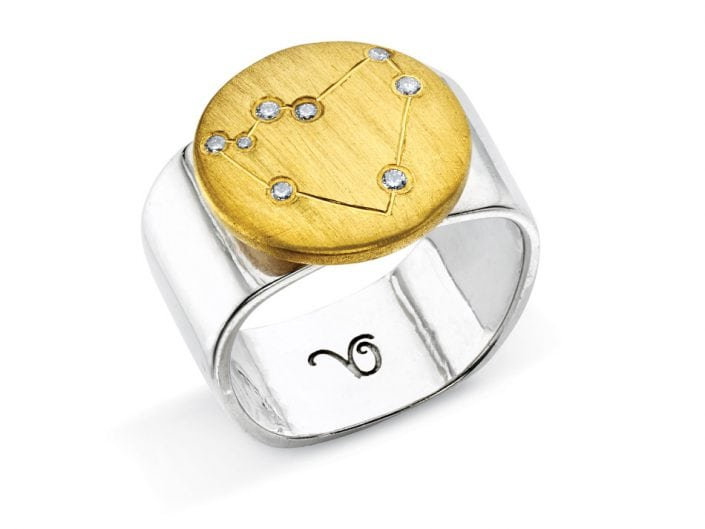 Ring of 22k gold disc atop a sterling silver band features glittering high-quality diamonds outlining star sign constellation of Capricorn.