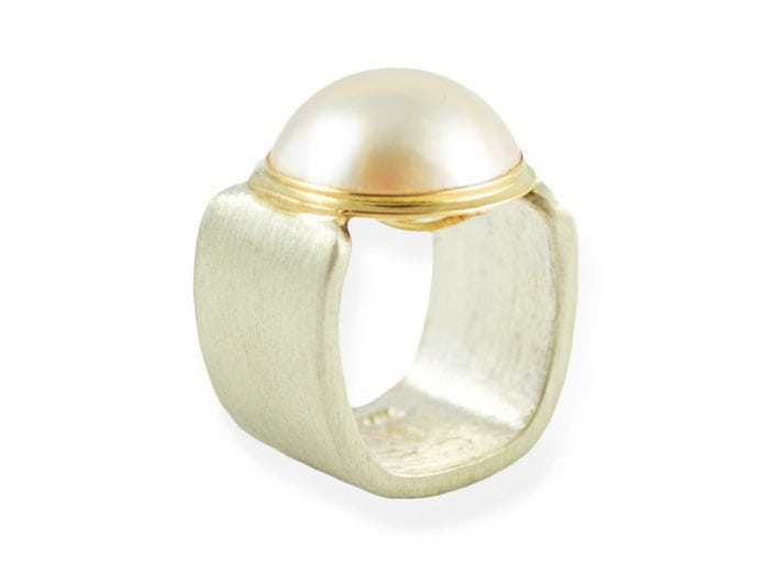 Mabe pearl in a 14k gold bezel setting atop a square, brushed sterling silver band.
