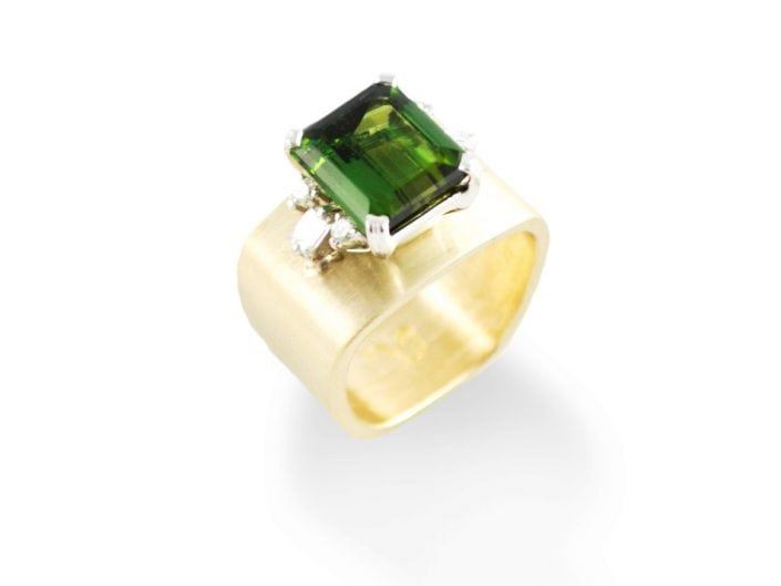 Three carat mint green tourmaline in a 14k white gold setting with 0.37 ctw prong-set diamonds on the shoulders atop a brushed 14k yellow gold band.