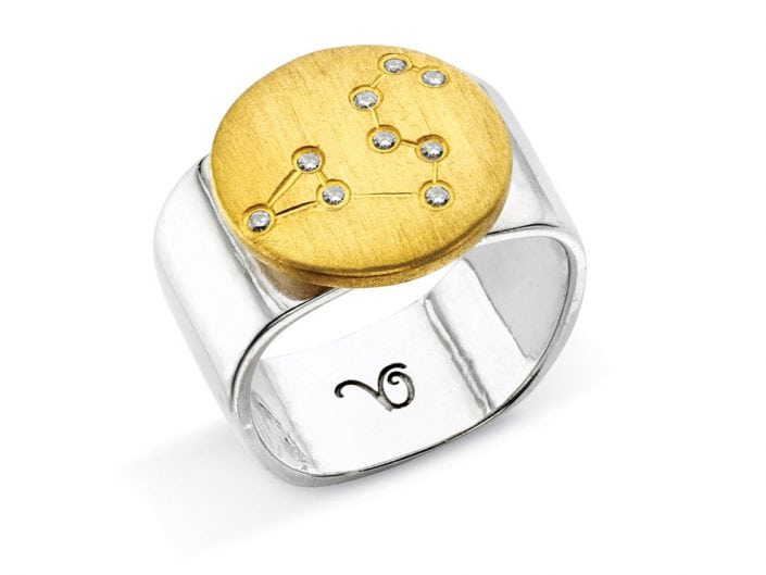 Ring of 22k gold disc atop a sterling silver band features glittering high-quality diamonds outlining star sign constellation of Leo.
