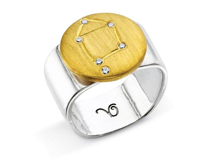 Ring of 22k gold disc atop a sterling silver band features glittering high-quality diamonds outlining star sign constellation of Libra.