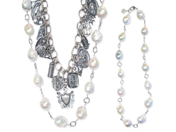 Wear this necklace in any of the 4 ways to fit your style. Large strand of pearls paired with sterling silver religious charms.