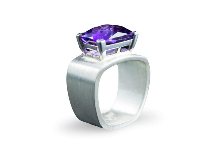Stunning amethyst set in 14k white gold on a square, brushed sterling silver band.