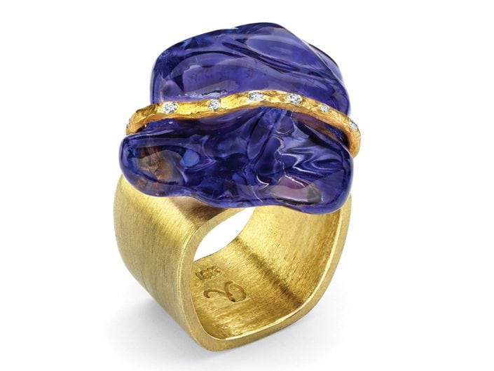 Large Tanzanite stone with a 22k gold, diamond studded ribbon atop a 18k gold square ring