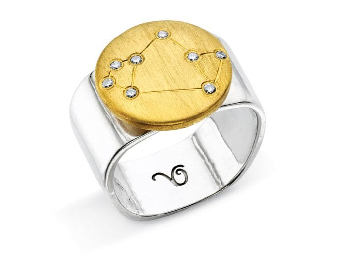 Ring of 22k gold disc atop a sterling silver band features glittering high-quality diamonds outlining star sign constellation of Sagittarius.