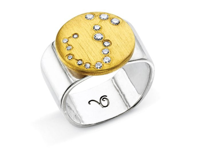 Ring of 22k gold disc atop a sterling silver band features glittering high-quality diamonds outlining star sign constellation of Scorpio.