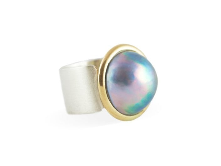 Tahitian pearl in a 14k gold bezel setting atop a square, brushed sterling silver band.