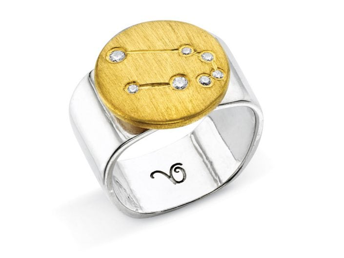 Ring of 22k gold disc atop a sterling silver band features glittering high-quality diamonds outlining star sign constellation of Taurus.